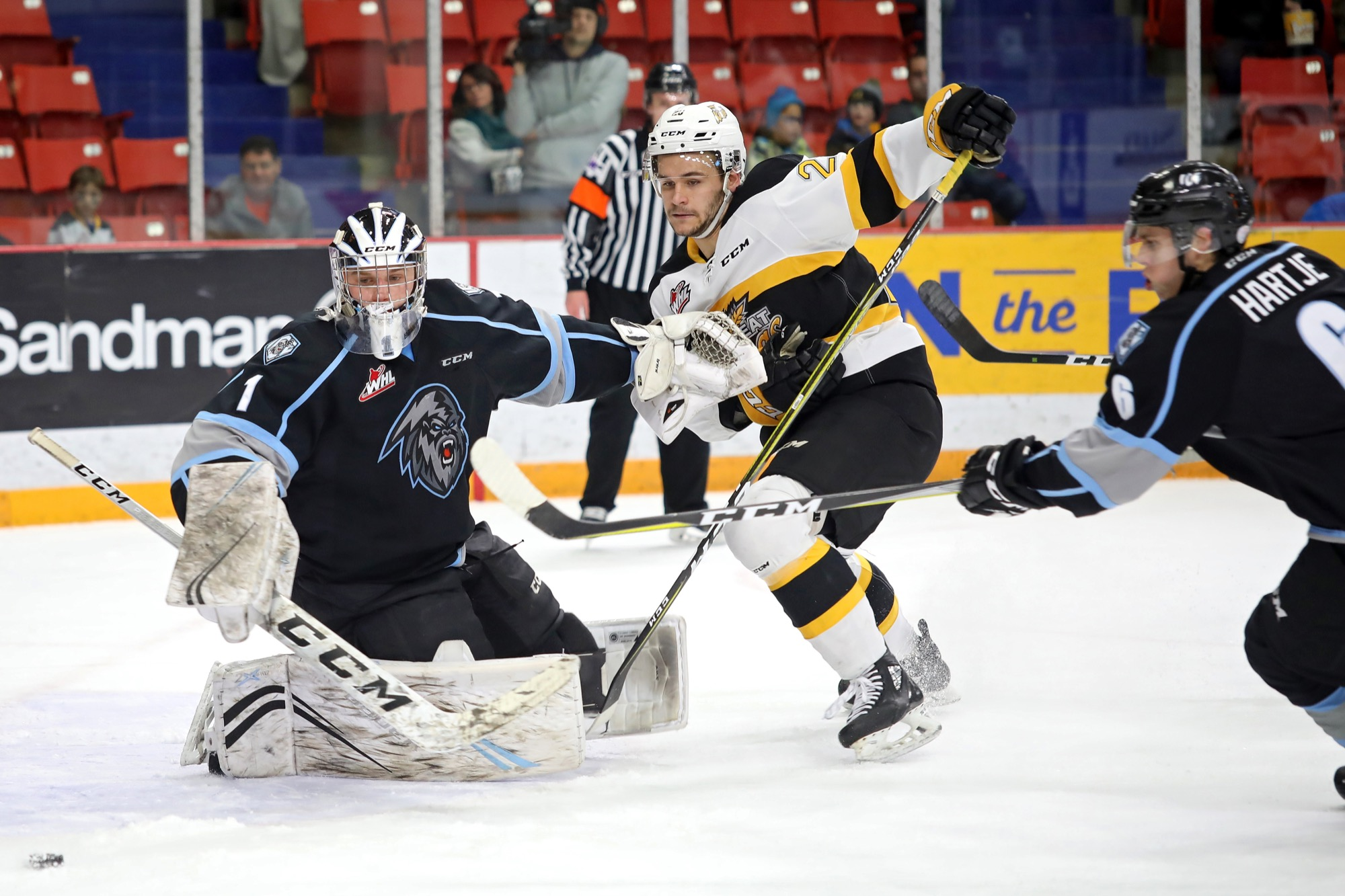 Baron Thompson of the Brandon Wheat Kings and Chase Hartje of the Kootenay Ice chase the puck in front of Ice netminder Jesse Makaj during Western Hockey League action at Westoba Place earlier this year. Tim Smith / Brandon Sun