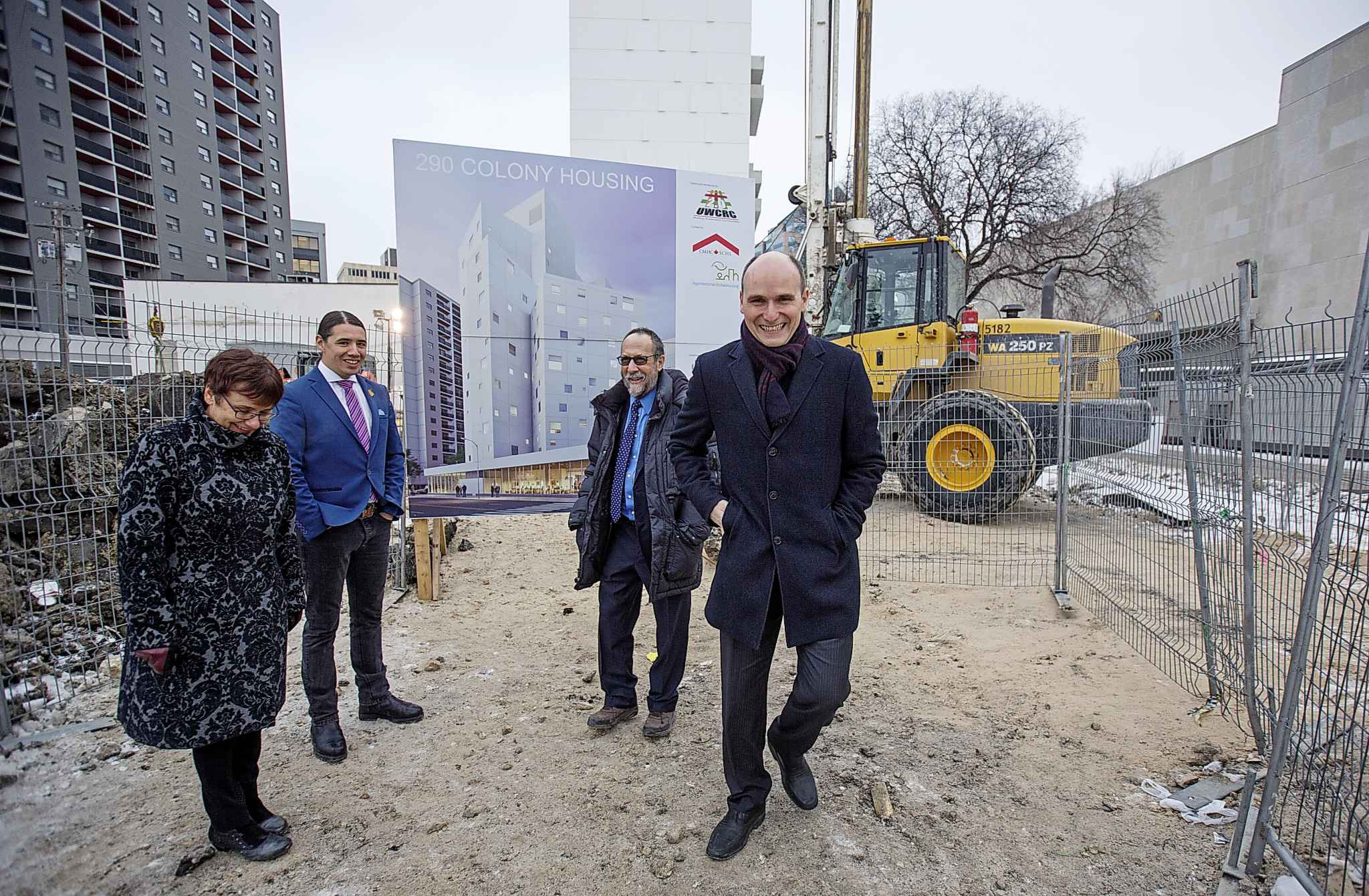 Jean-Yves Duclos (right), minister responsible for the Canada Mortgage and Housing Corp., and Annette Trimbee, vice-chancellor of the University of Winnipeg, Sherman Kreiner, head of the U of W Community Renewal Corp. and Robert-Falcon Oullette, MP for Winnipeg Centre, at the site of the $26-million housing project west of the Winnipeg Art Gallery Wednesday.