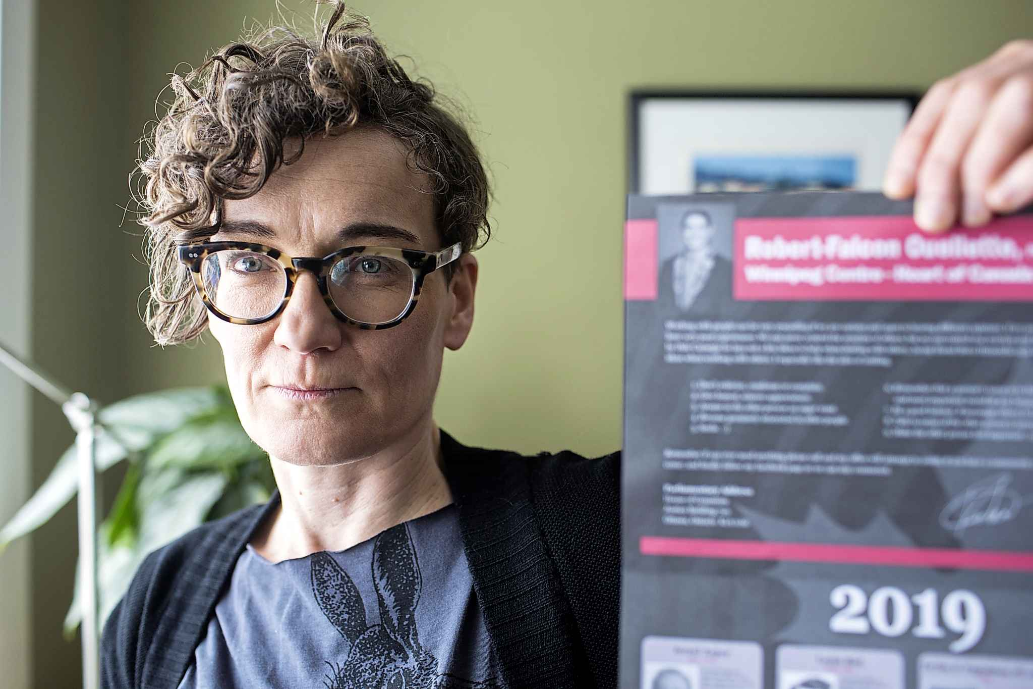 "English professor Heather Milne with the all-male ""notable Canadians"" calendar that liberal MP Robert-Falcon Ouellette sent out in Winnipeg on Wednesday."