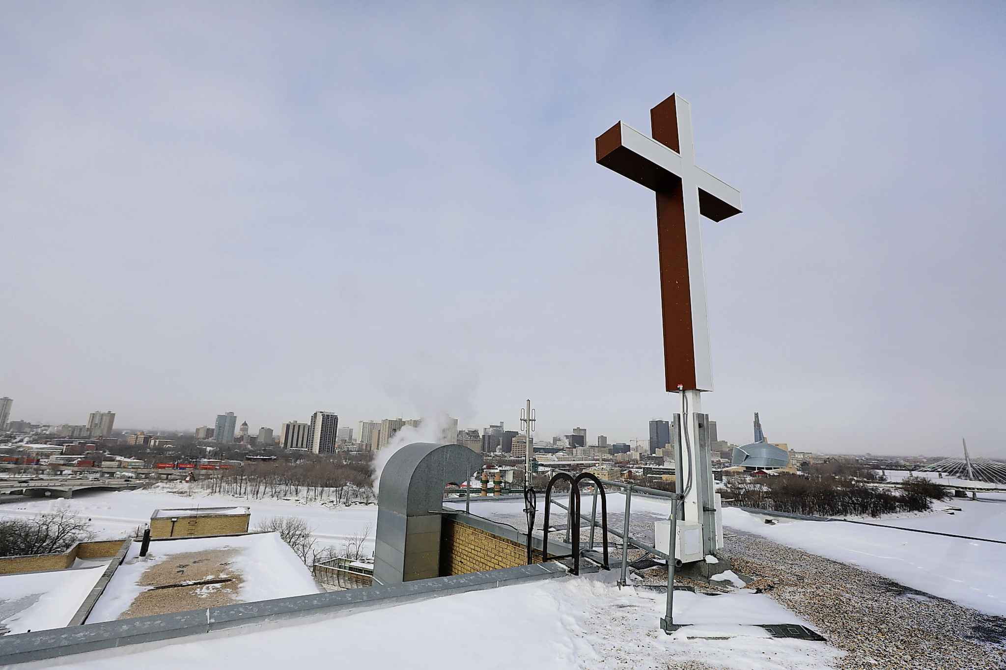 The cross replaced the old one which was installed in 1953.