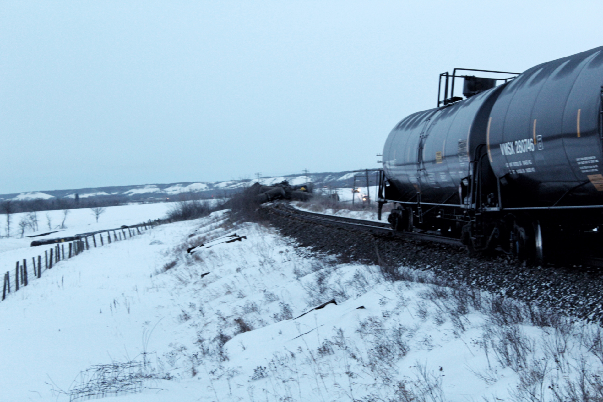 About three dozen CN railcars derailed near St. Lazare early Saturday morning, causing a partial leak of crude oil.