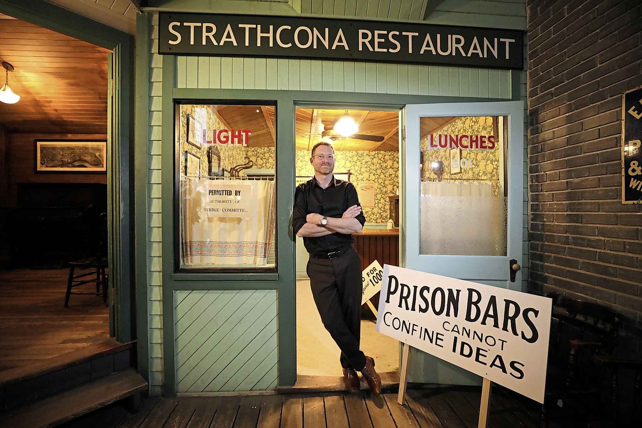 Manitoba Museum curator of history Roland Sawatzky stands in a replica of the Strathcona restaurant, part of the 1919 General Strike exhibit at the museum. (Ruth Bonneville / Winnipeg Free Press)