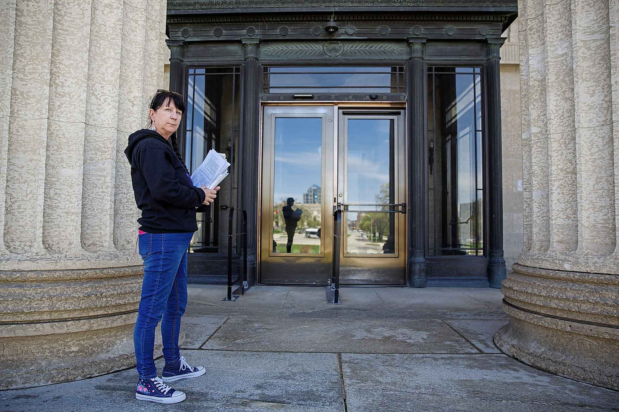 MIKE DEAL / WINNIPEG FREE PRESS  Carrying an armful of documents she is handing over to the NDP the Official Opposition, Arlene Last-Kolb has been working with Overdose Manitoba to petition the provincial government to take action on the addictions crises.
