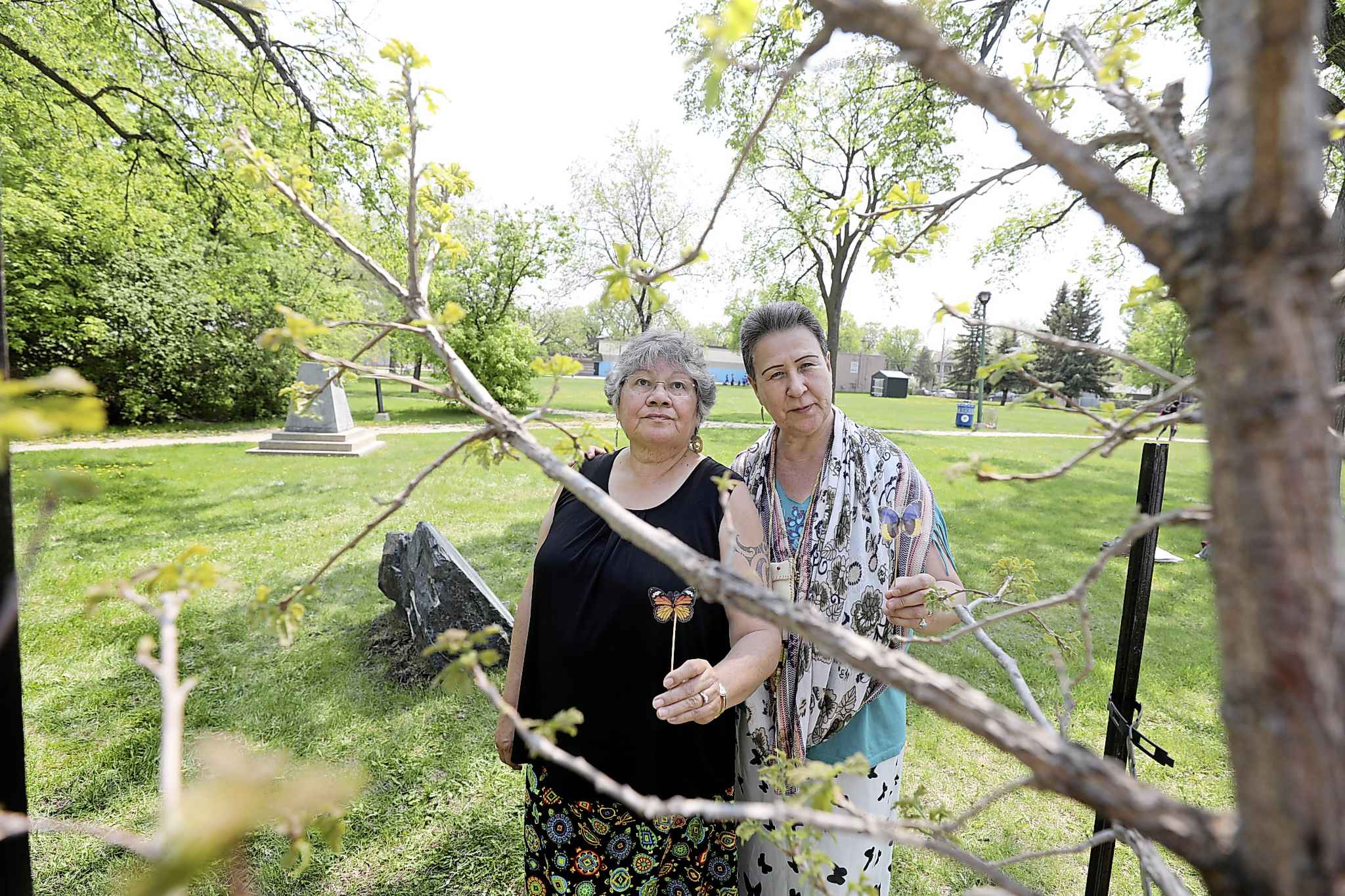 Mary Graham (right)  and elder Belinda Vandenbroeck, next to the memorial tree in Michaëlle Jean Park.