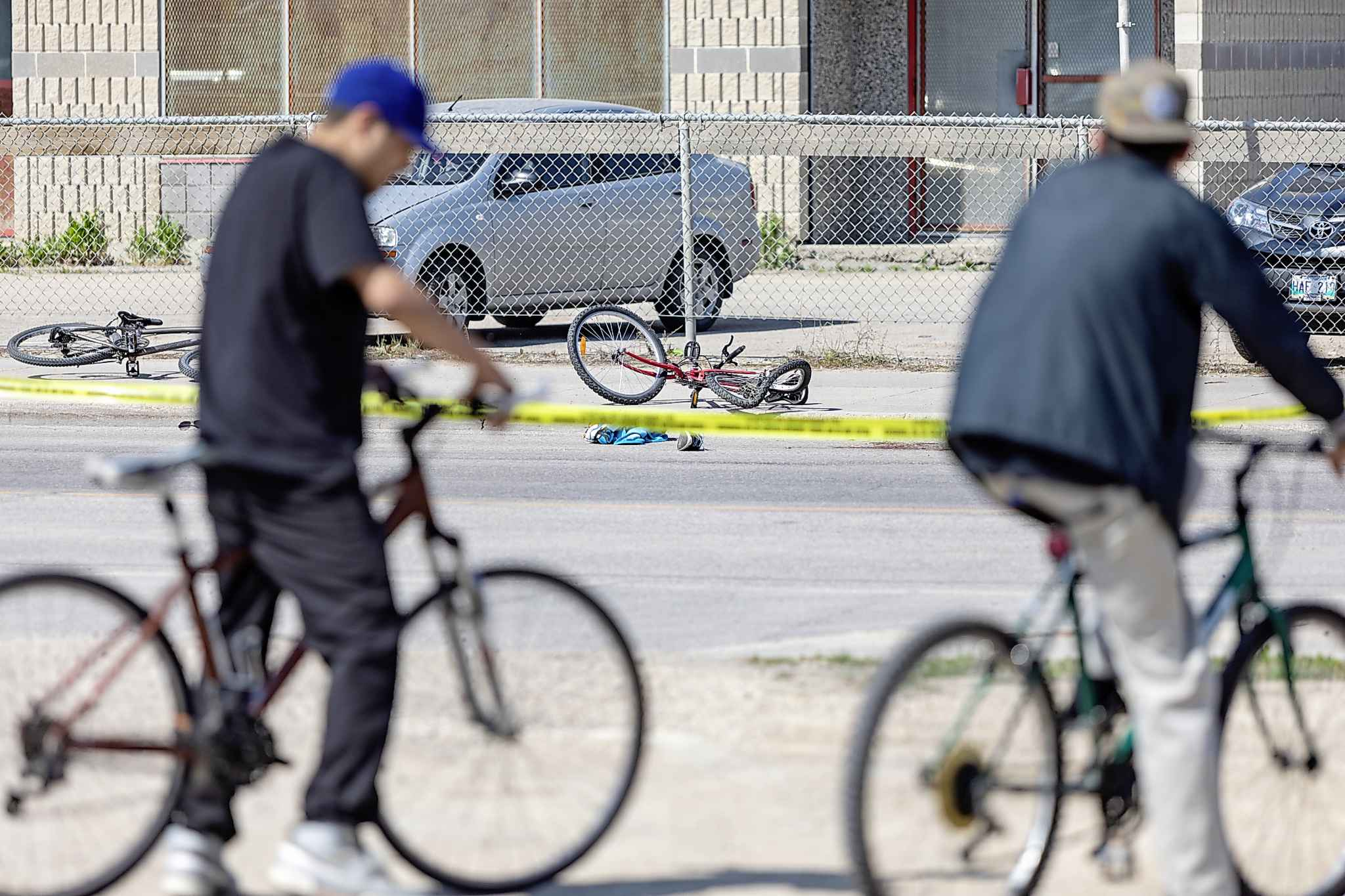 SASHA SEFTER / WINNIPEG FREE PRESS FILES</p><p>Two cyclists stop to survey the scene of a recent fatal accident involving a truck and a cyclist on Higgins Avenue between Princess and King Streets. Of the total Winnipeg collisions reported in 2012-15, about 36 per cent of the fatal collisions involved a pedestrian.</p>