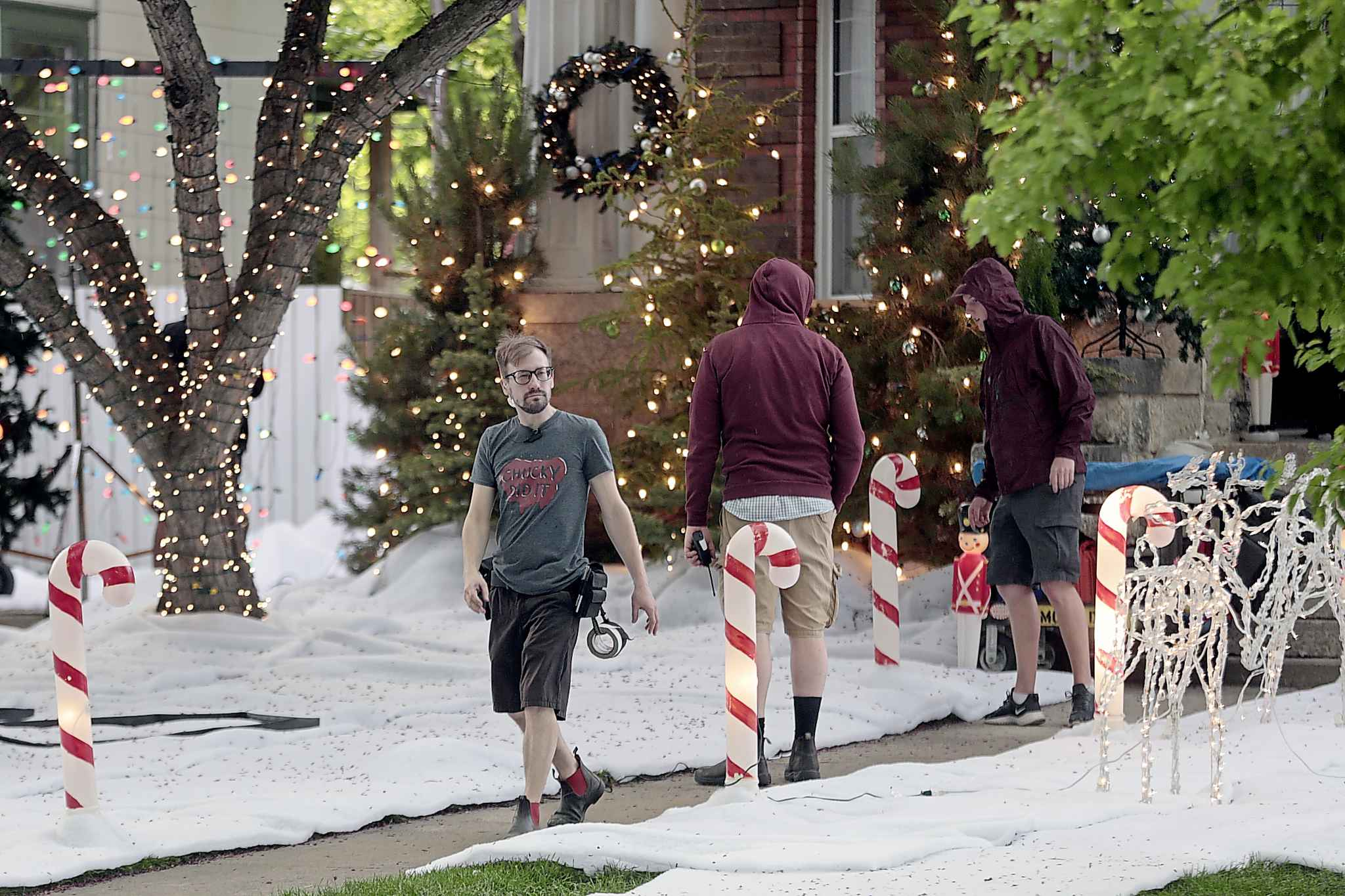 Crew members for the movie 'Two Turtle Doves' put the finishing touches on a winter set on Kingsway between Wellington and Stafford in a steady rain and a smattering of canker worms in June 2019. PHIL HOSSACK / WINNIPEG FREE PRESS FILES