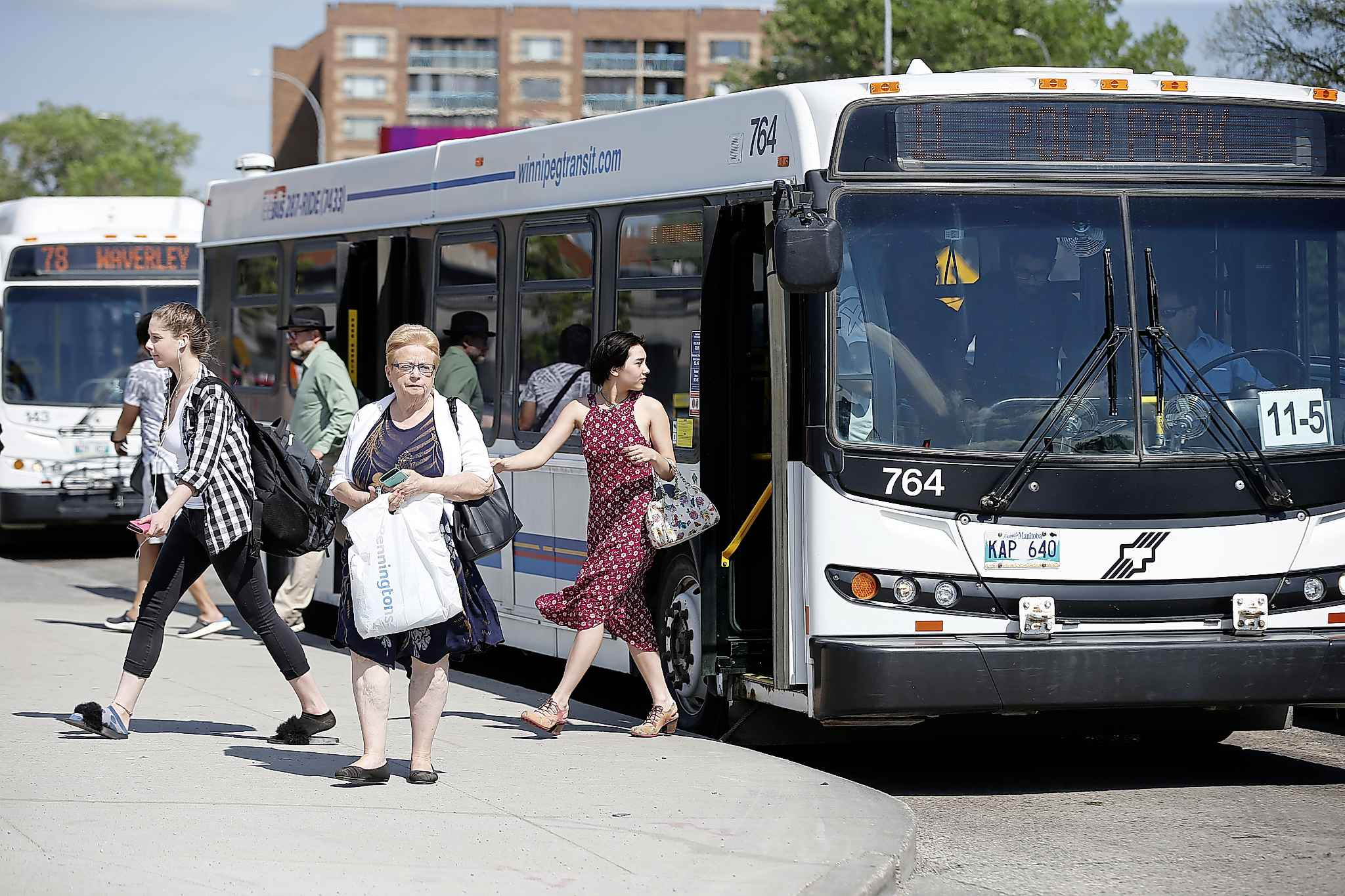 A bus that arrives late can initiate a chain reaction of misfortune for passengers who are then too late to connect with other buses, and possibly made late for appointments, school or jobs. (John Woods / Free Press files)