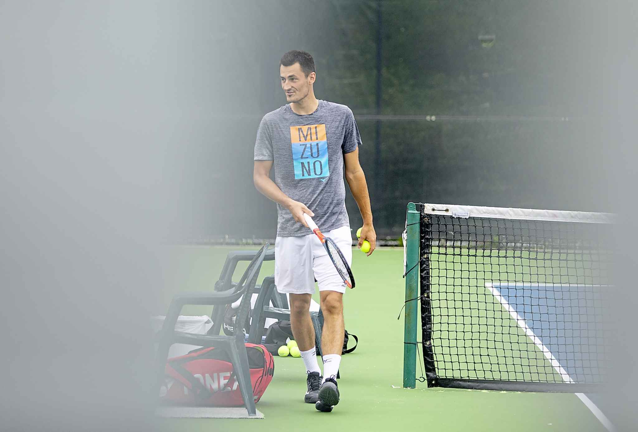 Australian tennis pro Bernard Tomic gets in some practice Tuesday morning before competing in the National Bank Challenger at the Winnipeg lawn Tennis Club.