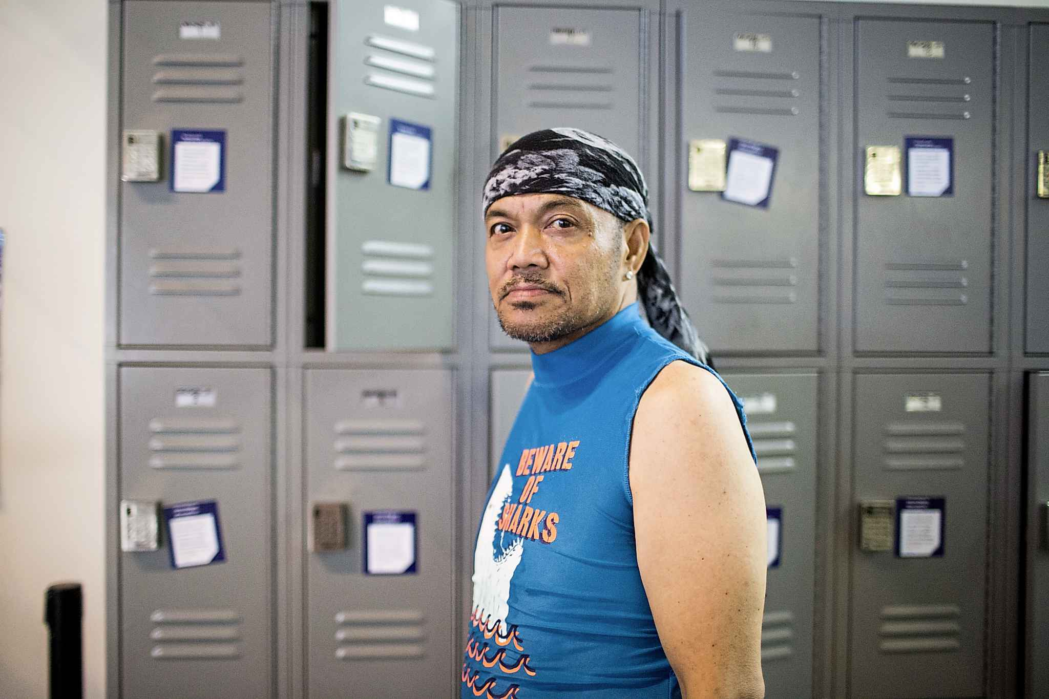 Library patron Rikiboi Sambulad uses the lockers at the Millennium Library.