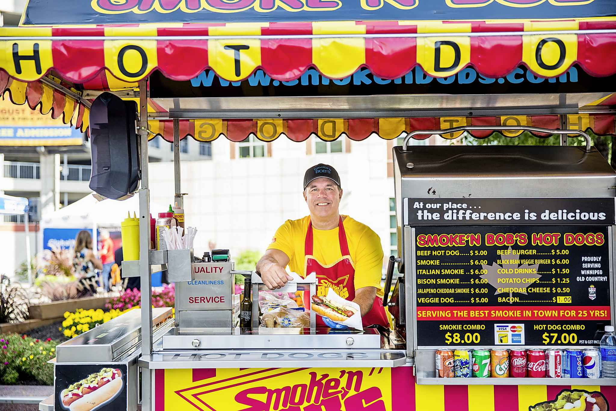 MIKAELA MACKENZIE / WINNIPEG FREE PRESS</p><p>Darren Yewchyn, the owner of Smoke'n Bob's Hot Dogs, holds a $100 smokie made from Wagyu beef (the best available) and topped with real gold leaf, which he'll be selling to raise money for Riverview Health Centre.</p>