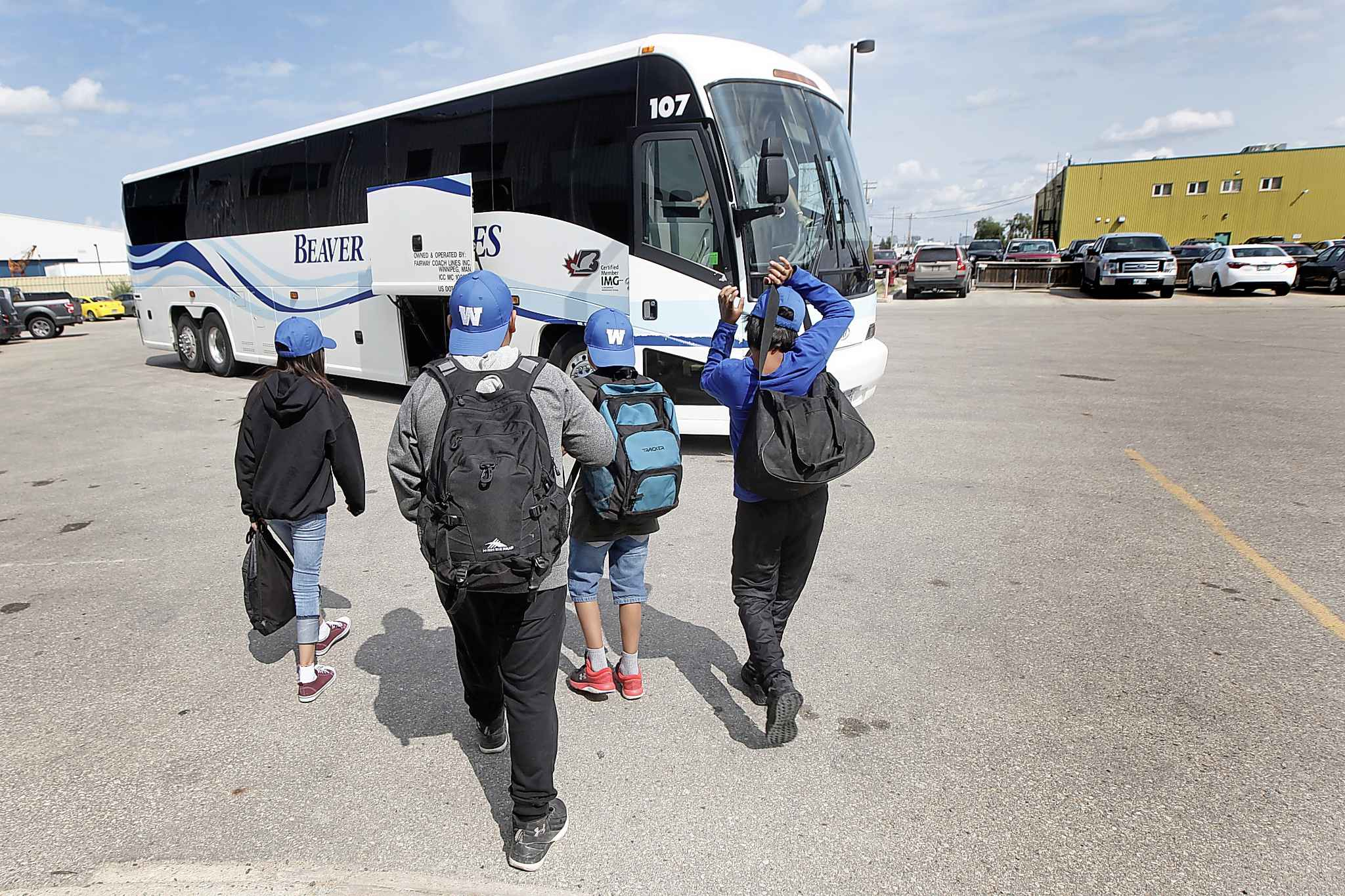 The children head towards a chartered bus to attend the Bombers/Lions game.</p>