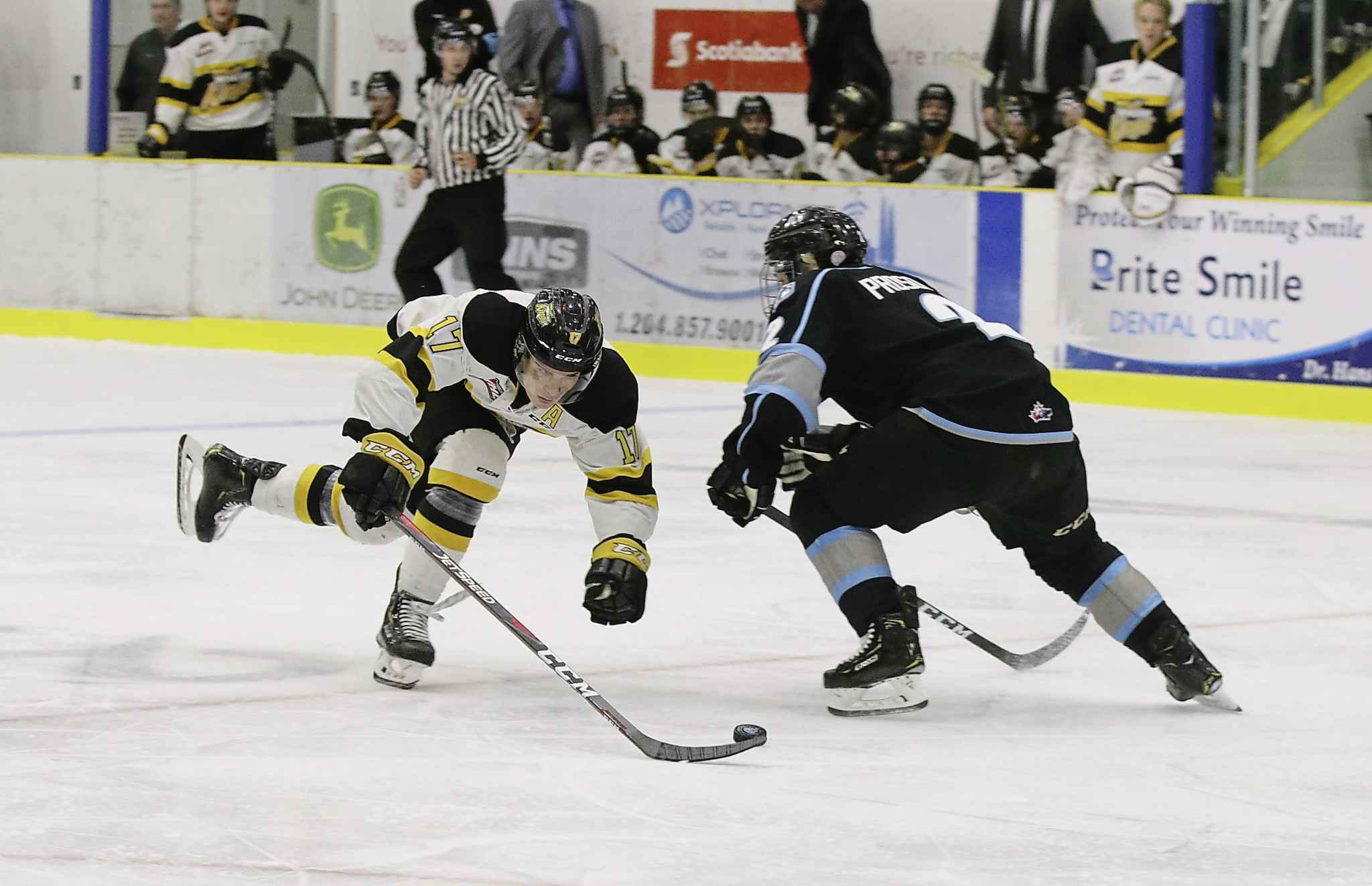 Forward Ridly Greig of the Brandon Wheat Kings unsuccessfully tries to dance around Winnipeg Ice defender Karter Prosofsky during Western Hockey League pre-season action at Portage la Prairie's Stride Place on Saturday, Sept. 7, 2019. Winnipeg won 5-1. (Perry Bergson/The Brandon Sun)