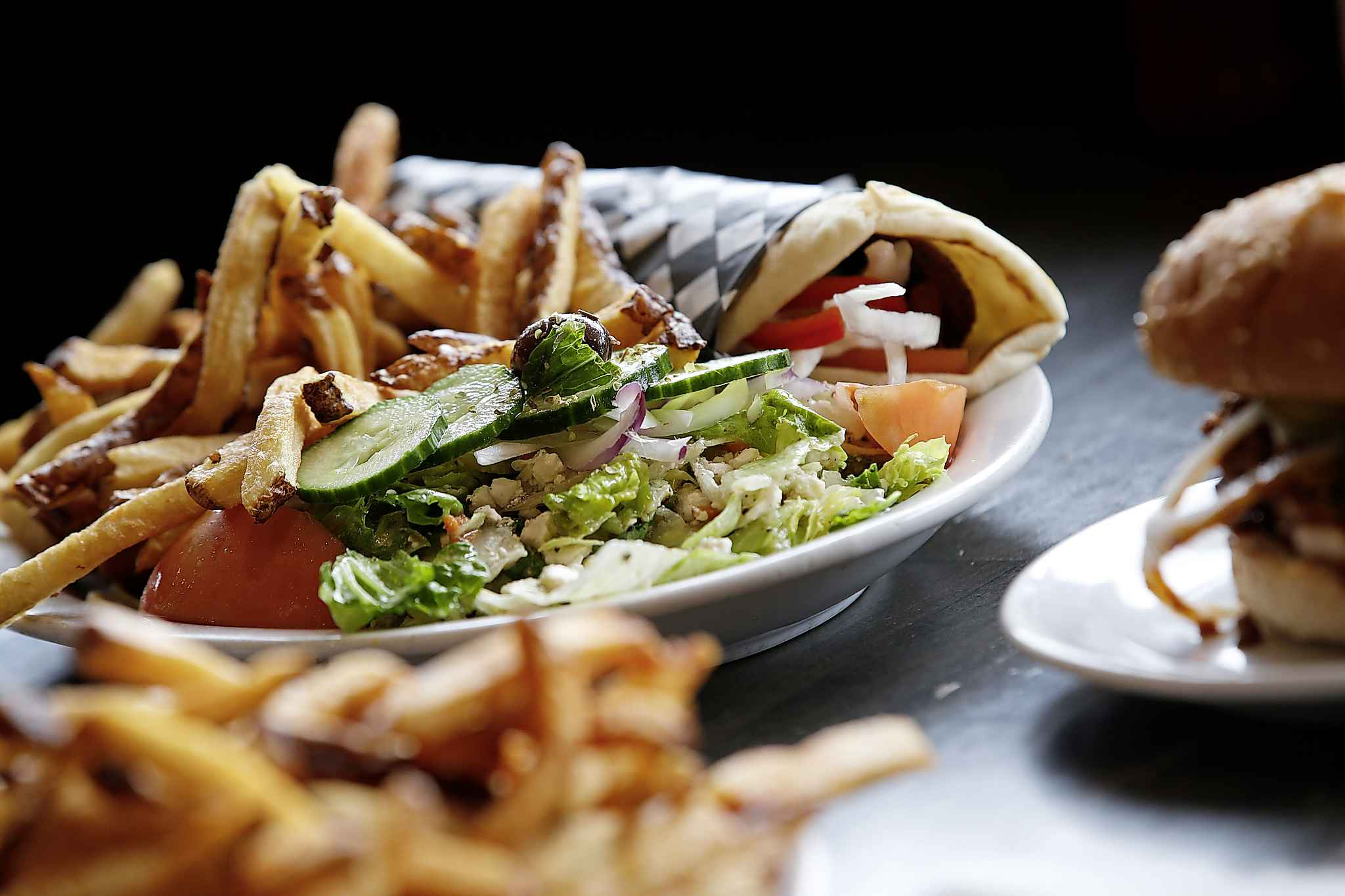 The menu mixes up standard drive-in items with a few Greek specialties. (John Woods / Winnipeg Free Press)