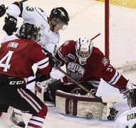 Guelph Storm goalie Justin Nichols gets his pad in the way of London Knights Bo Horvat during first period action in Game 6 of the Memorial Cup CHL hockey tournament, in London, Ont., Wednesday, May 21, 2014. A class action lawsuit has been launched against the Canadian Hockey League seeking financial compensation for allegedly underpaid players. THE CANADIAN PRESS/Dave Chidley
