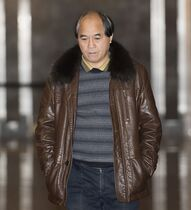 Diran Lin, father of Jun Lin, is shown at the Montreal Courthouse on the fifth day of jury deliberations in the murder trial for Luka Rocco Magnotta, Saturday, December 20, 2014. Magnotta is charged in connection with the death and dismemberment of university student Jun Lin case that made international headlines. THE CANADIAN PRESS/Graham Hughes