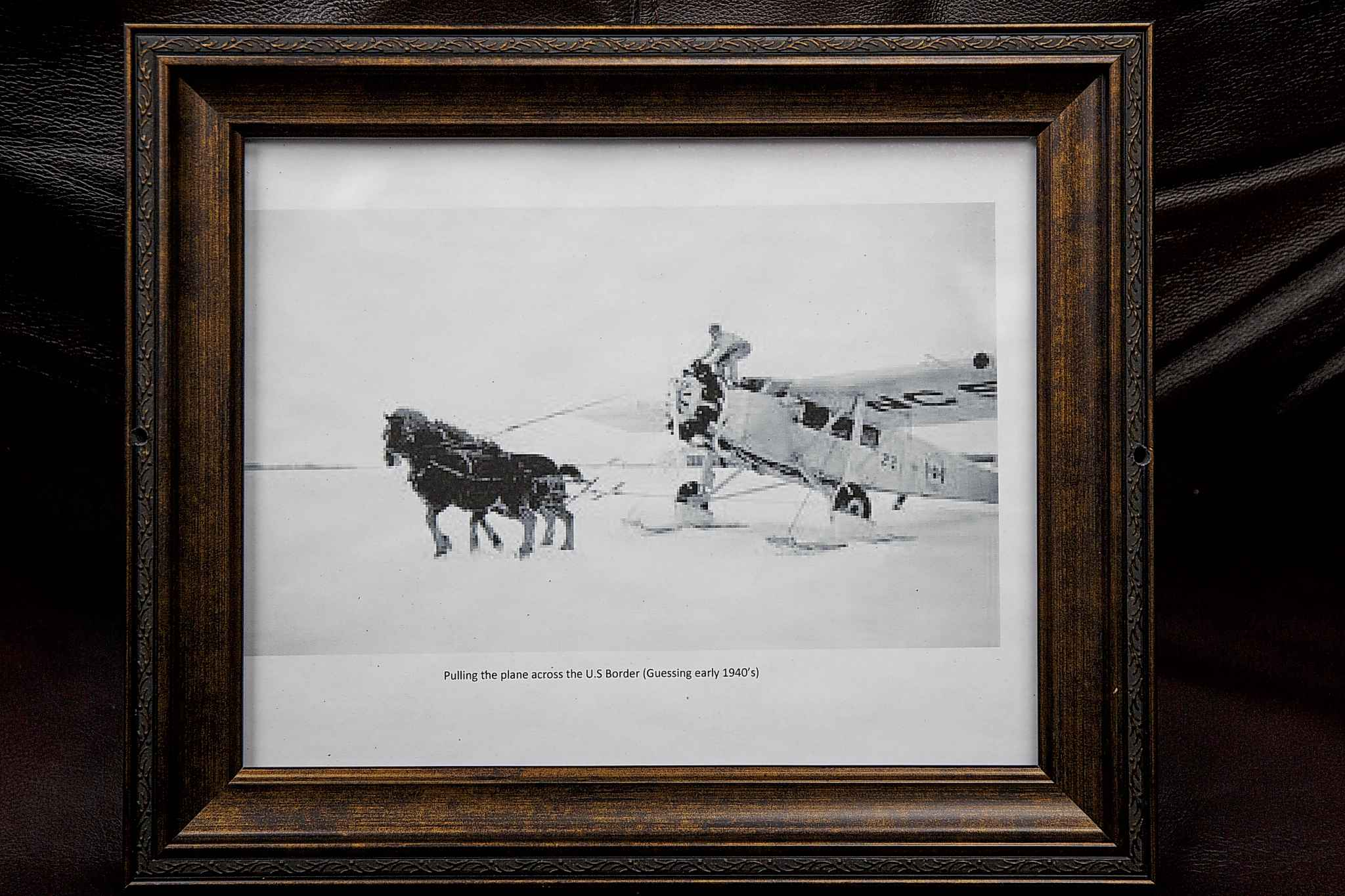 Wilwand has photo of a plane being pulled by horses in his office. (Mike Deal / Winnipeg Free Press)