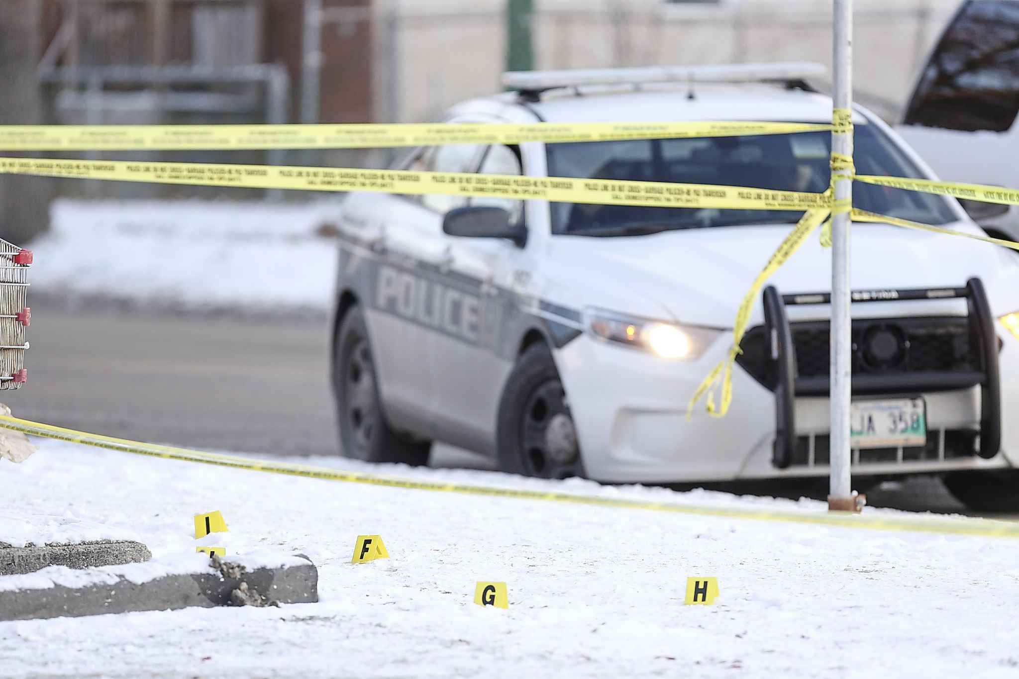 Winnipeg police are still investigating the scene at the 7-Eleven at Ellice Avenue and Arlington Street. (Mike Deal / Winnipeg Free Press)