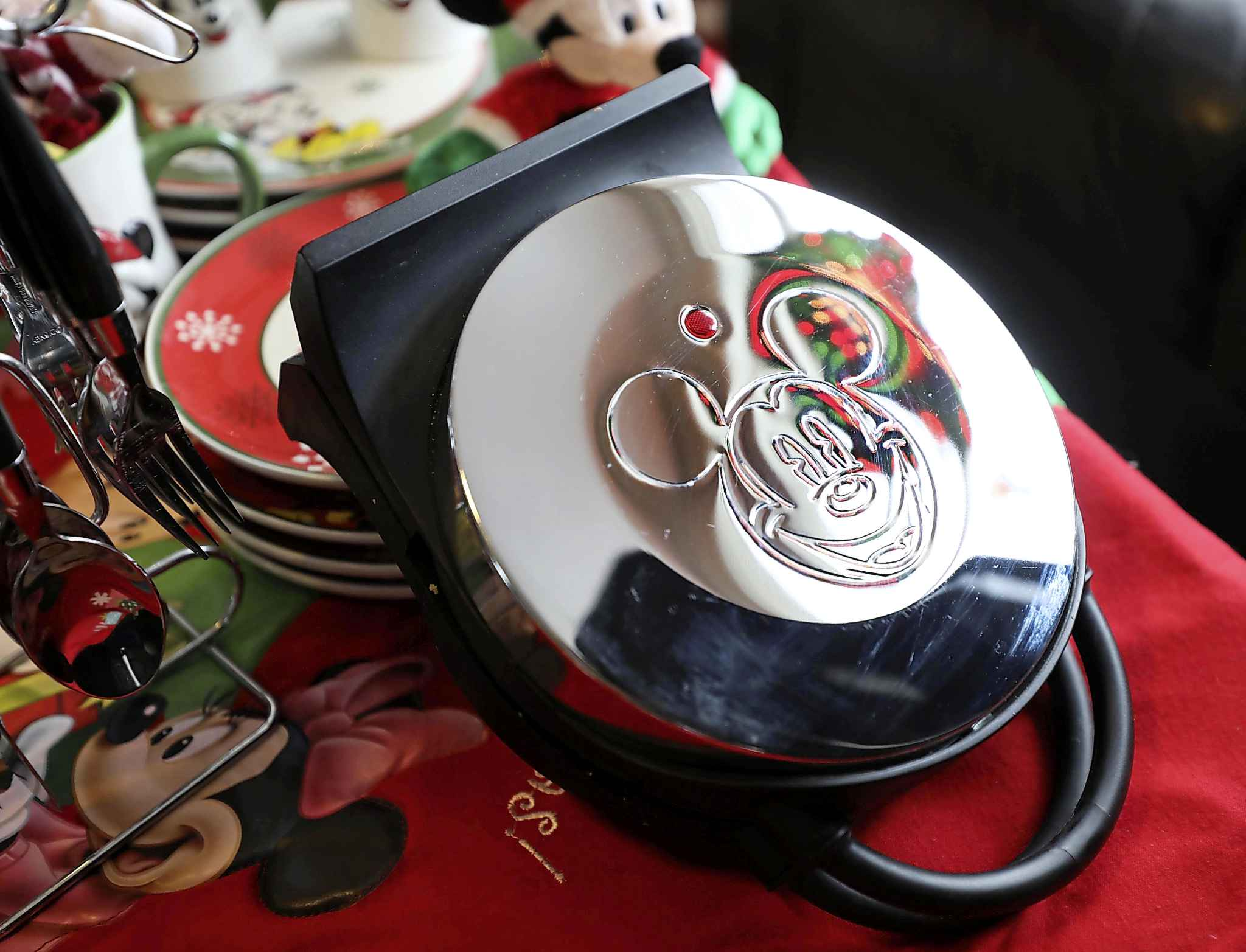 Bradley-Bauhuaud doesn't waffle when it comes to Mickey Mouse memorabilia. (Ruth Bonneville / Winnipeg Free Press)     INTERSECTION - Mickey Mouse      Michelle Bahuaud's (Mickey's) incredibly large collection of  Mickey Mouse  items.  Photo of a waffle iron that makes waffles in the shape of Mickey Mouse.      For a Christmas-y Intersection piece on Michelle, who goes by Mickey, who collects Mickey Mouse paraphernalia. She has shelves, cabinets and even an entire room in her home devoted to her favourite mouse.  She has decorated her entire Christmas tree and her living room for Christmas this year, exclusively with her MM ornaments, etc.       See Dave Sanderson story.     Nov 25th   2019