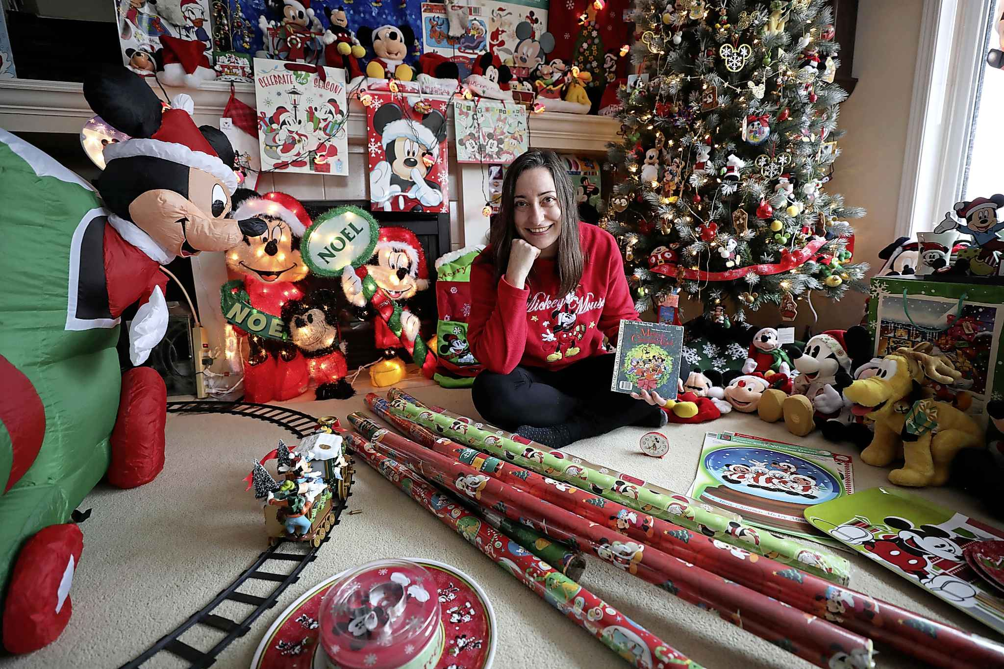 Michelle Bradley-Bahuaud has a collection of Mickey Mouse memorabilia that might even impress the folks at Disney. (Ruth Bonneville / Winnipeg Free Press)      INTERSECTION - Mickey Mouse    Photo of Michelle Bahuaud and her Mickey Mouse themed Christmas decorations in her living room.      Michelle Bahuaud's (Mickey's) incredibly large collection of  Mickey Mouse  items.    For a Christmas-y Intersection piece on Michelle, who goes by Mickey, who collects Mickey Mouse paraphernalia. She has shelves, cabinets and even an entire room in her home devoted to her favourite mouse.  She has decorated her entire Christmas tree and her living room for Christmas this year, exclusively with her MM ornaments, etc.       See Dave Sanderson story.     Nov 25th   2019