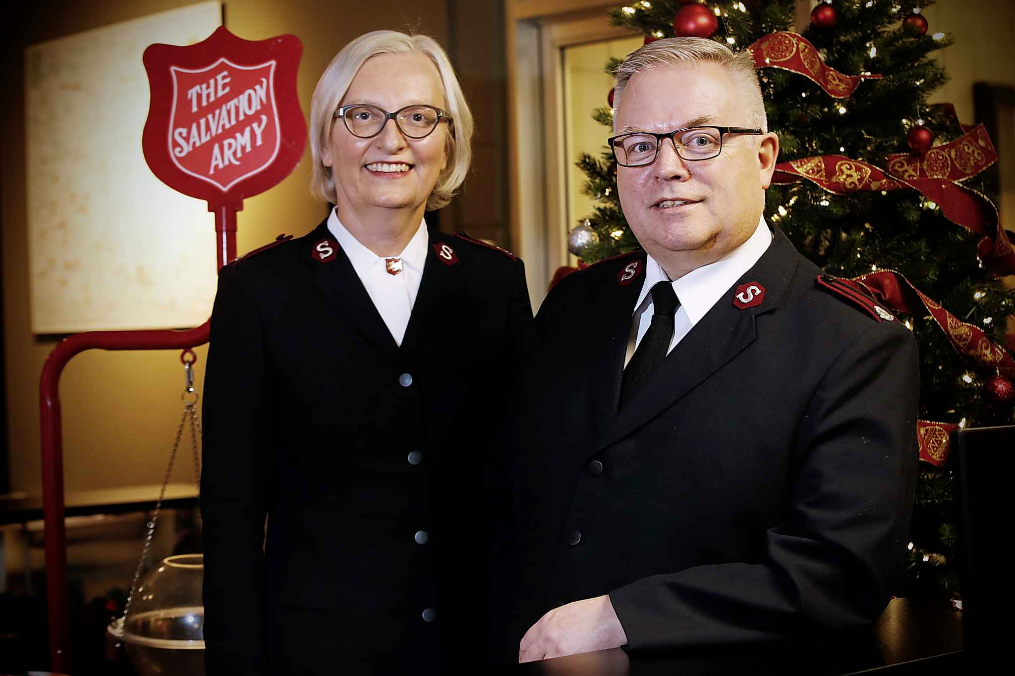 Maj. Brenda Critch and Maj. Shawn Critch humbly downplay a suggestion they are the unsung heroes of the holiday season. (John Woods / Winnipeg Free Press)