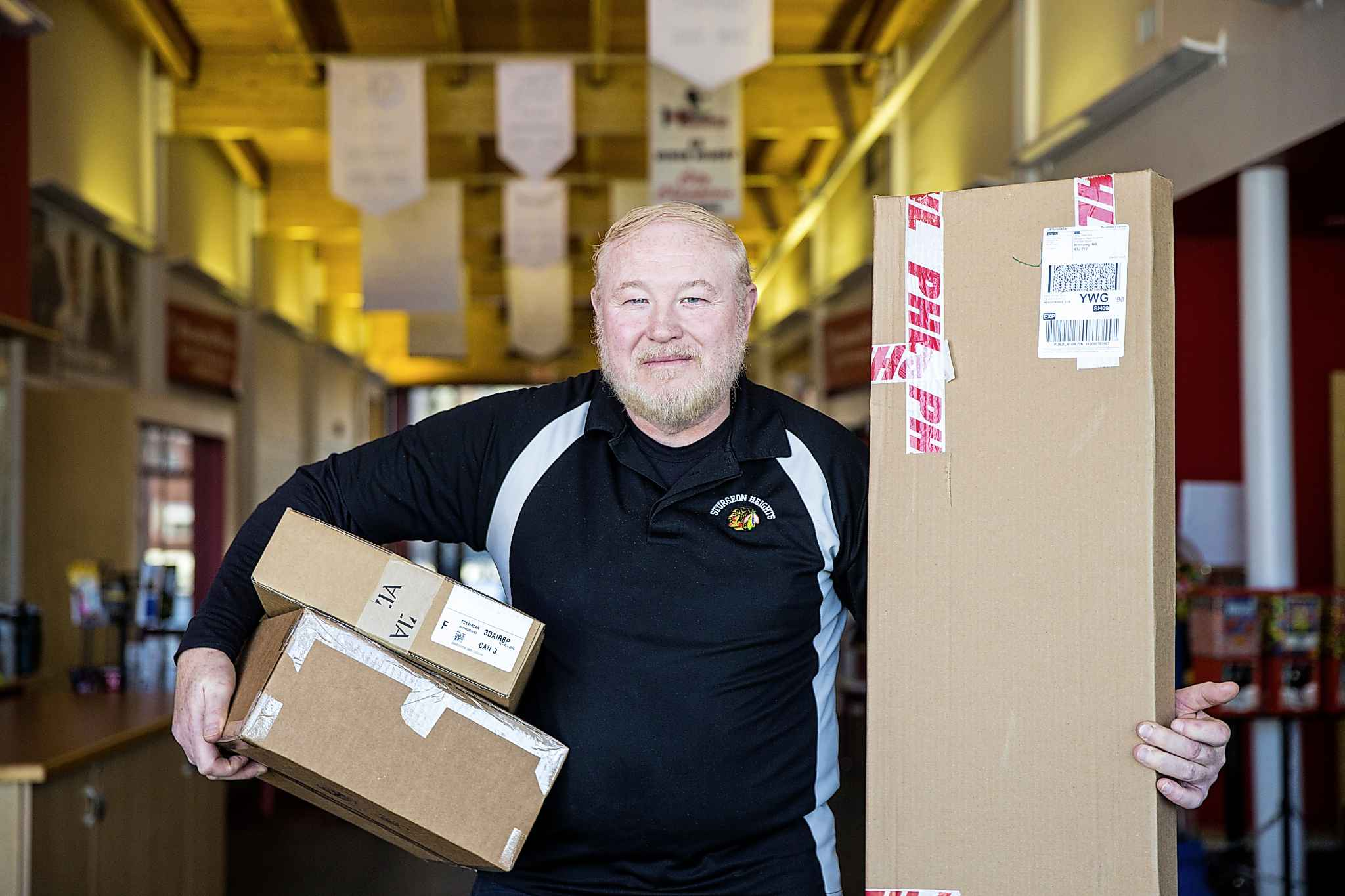 Barry Chambers, facility manager at the Sturgeon Heights Community Centre, says that the safe package delivery program has been so successful that the centre might offer it all the time. (Mikaela MacKenzie / Winnipeg Free Press)