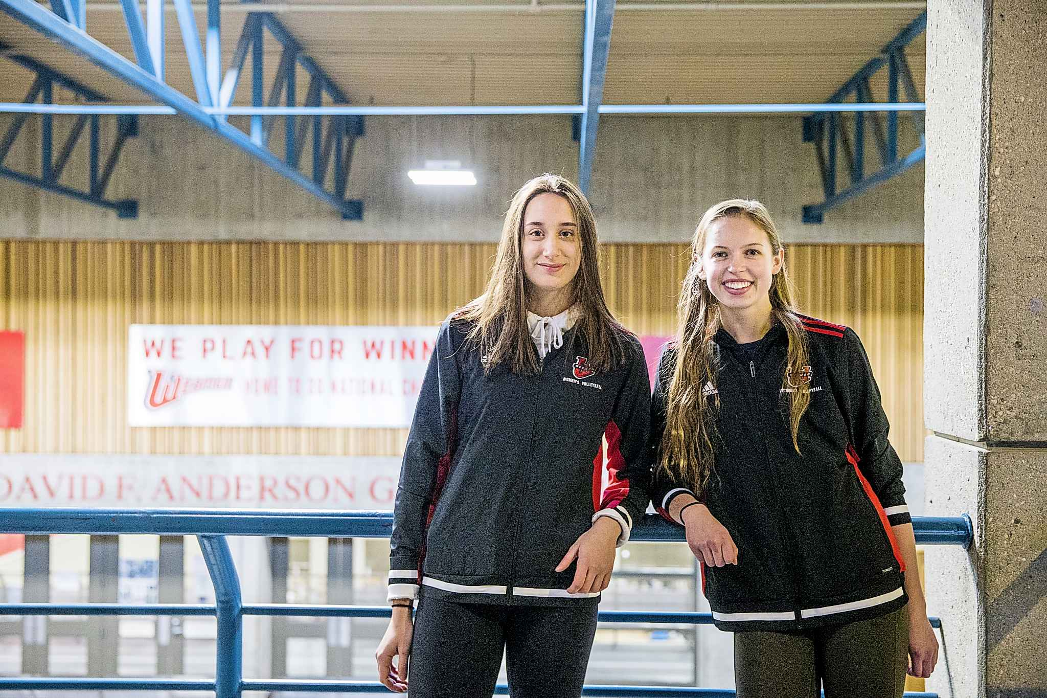 Wesmen volleyball players Selva Planincic (left) and Rylie Dickson have already won more games this year at the midpoint compared to all of last season. (Mikaela MacKenzie / Winnipeg Free Press)