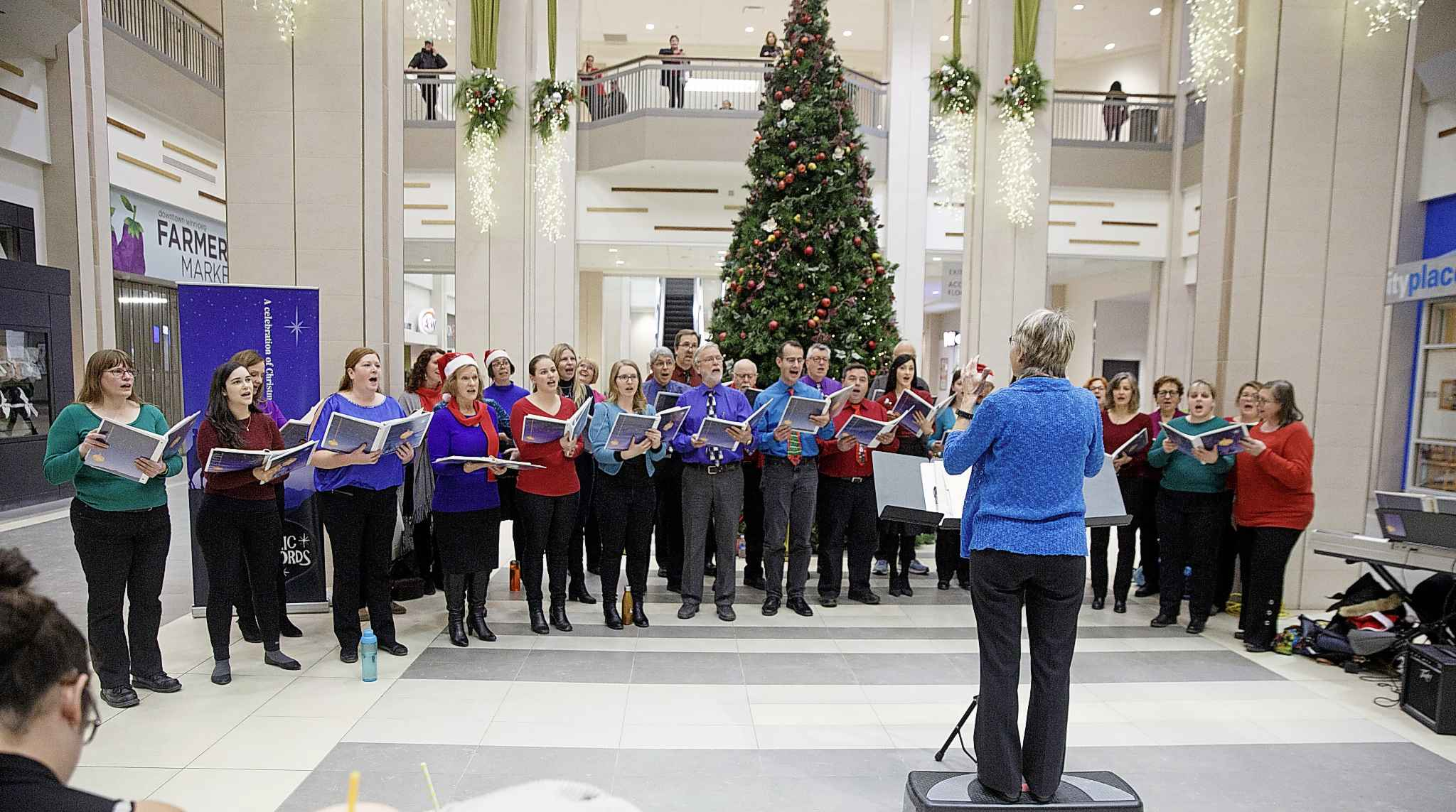 The Electric Chords — Manitoba Hydro's Christmas choir —still performs regularly every year. On Monday, they sang at Cityplace during the lunch hour. (Mike Deal / Winnipeg Free Press)