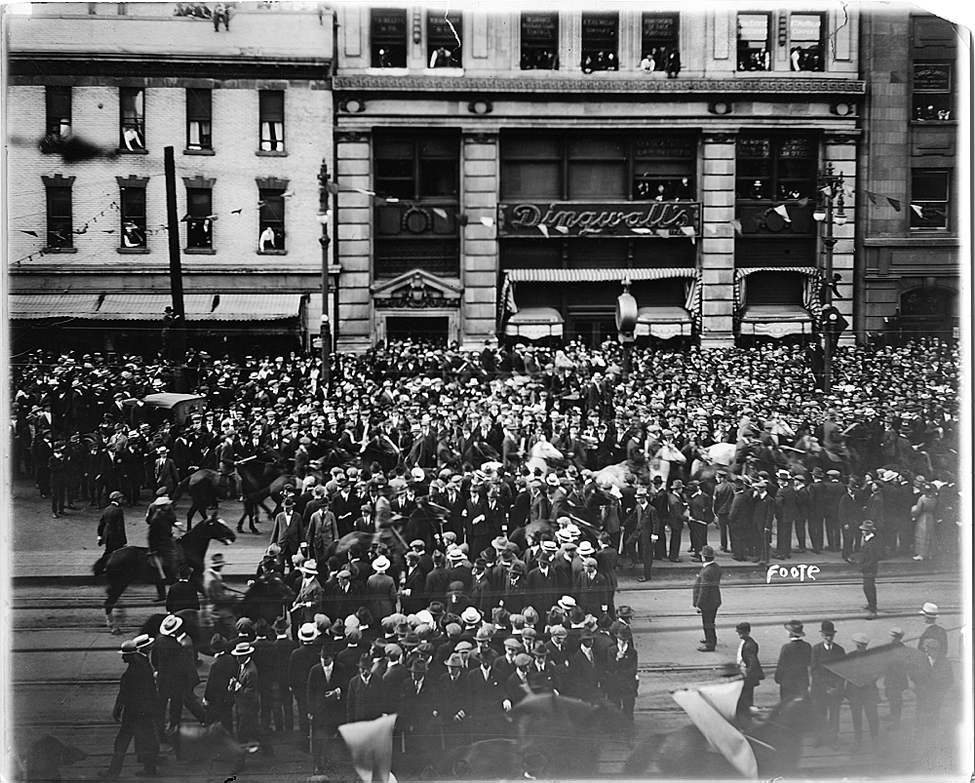 L. B. Foote / Winnipeg Free Press Archives 1919 Strike June 10th Portage Avenue, at corner of Main Street Crowd outside drug store, during street demonstration Tuesday afternoon.
