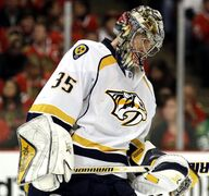 Nashville Predators goalie Pekka Rinne looks down during the second period in Game 6 of an NHL Western Conference hockey playoff series against the Chicago Blackhawks, Saturday, April 25, 2015, in Chicago. (AP Photo/Nam Y. Huh)