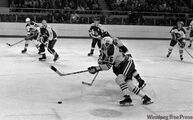 Ulf Nilsson , Anders Hedberg and Bobby Hull in a game against the Phoenix Roadrunners in the World Hockey Association.