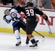 Anaheim Ducks left wing Matt Beleskey, right, gives Winnipeg Jets defenceman Toby Enstrom a rough ride during the second period of Game 1 Thursday night. The Jets played a solid game Thursday and won't alter their plan.