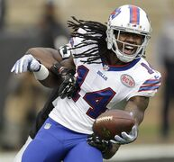 Buffalo Bills wide receiver Sammy Watkins (14) reacts after catching a 42-yard touchdown pass in front of Oakland Raiders cornerback D.J. Hayden during the first quarter of an NFL football game in Oakland, Calif., Sunday, Dec. 21, 2014. (AP Photo/Ben Margot)