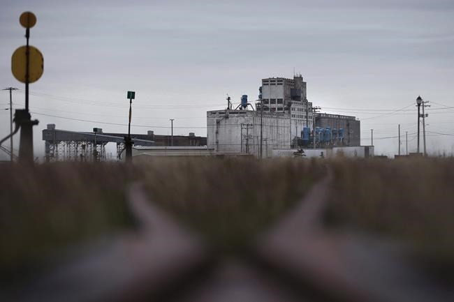 The company that owns the broken rail line to Churchill, Manitoba says negotiations to sell the line and restore it are back on. The closed rail line and port in Churchill, Mba., is seen on Monday, July 2, 2018. THE CANADIAN PRESS/John Woods