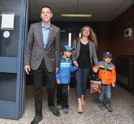 Mayoral candidate Brian Bowman and his family arrives at a polling station this morning to vote in the civic election.