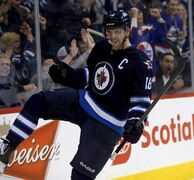 Winnipeg Jets' Andrew Ladd (16) celebrates after scoring against the Tampa Bay Lightning during second period NHL hockey action in Winnipeg, Tuesday, April 16, 2013. A realigned and highly competitive Central Division may cut travel time for the Winnipeg Jets, but it does little for their goal of making the playoffs.THE CANADIAN PRESS/Trevor Hagan
