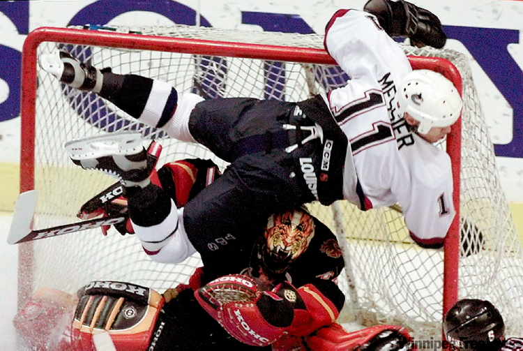Vancouver's Mark Messier slams into the post after scoring a goal against Calgary in this 1998 photo. Messier sustained a concussion on the play.
