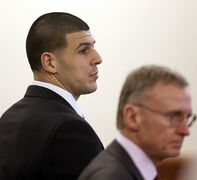 Former New England Patriots football player Aaron Hernandez, left, and defense attorney Charles Rankin, right, listen during his murder trial, Thursday, Jan. 29, 2015, in Fall River, Mass. Hernandez is charged with killing semiprofessional football player Odin Lloyd, 27, in June 2013. (AP Photo/Steven Senne, Pool)