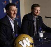 The Winnipeg Blue Bombers have announced a contract extension for quarterback Drew Willy, left, at a news conference Friday morning beside Coach Mike O'Shea.
