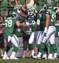 Saskatchewan Roughriders running back Anthony Allen celebrates with teammates against the Winnipeg Blue Bomberduring the 4th quarter of CFL action in Regina, Sask., Sunday, August 31, 2014. The Riders defeat the Bombers 35-30. THE CANADIAN PRESS/Liam Richards