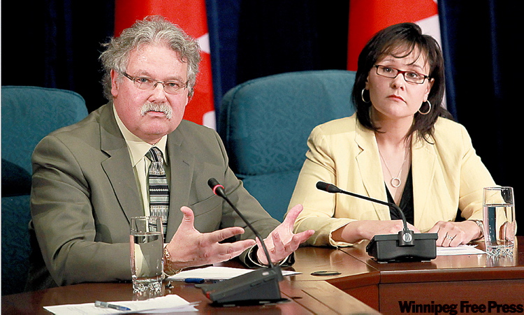 Chief Public Health Officer Dr. David Butler-Jones (left) and Health Minister Leona Aglukkaq have denied politics is the reason a pilot HIV vaccine facility isn't being established in Winnipeg.