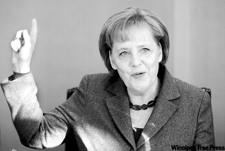 German Chancellor Angela Merkel reacts prior to the weekly cabinet meeting in Berlin, Germany, Wednesday, Feb. 3, 2010. (AP Photo/Markus Schreiber)