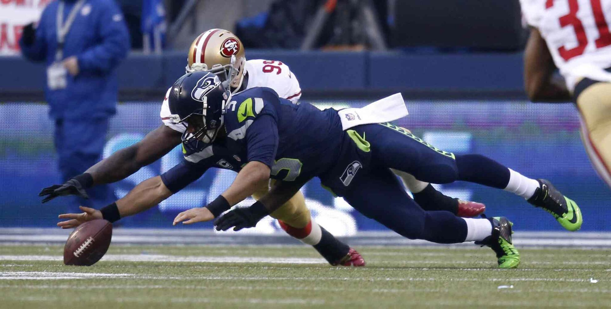 Seahawks QB Russell Wilson fumbles the ball. (Nhat V. Meyer / Tribune Media MCT)