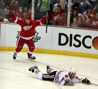 Red Wings' Gustav Nyquist and fans in Motor City celebrate his second-period goal Monday, while Blackhawks defenceman Brent Seabrook serves up a dandy visual metaphor for the 'Hawks' play of late, as Chicago has dropped two straight to the Wings to go behind 2-1 in the series.