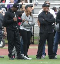 Ray Rice, right, and his wife Janay Rice attend the Ramapo versus New Rochelle high school football game at New Rochelle High School Saturday, Sept. 13, 2014, in New Rochelle, N.Y. The star running back was released by the Baltimore Ravens and suspended indefinitely by the NFL on Monday, Sept. 8, after video of him punching Janay was released. (AP Photo/The Journal News, Carucha L. Meuse) NYC OUT, TV OUT, NO SALES, MAGS OUT