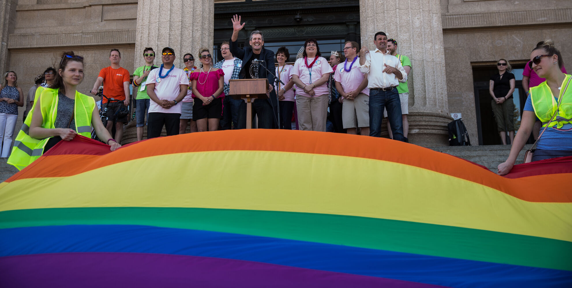 Premier Brian Pallister speaks to the crowd gathered on the steps of the Manitoba Legislative Building before the start of the Pride Parade Sunday.  (Mike Deal / Winnipeg Free Press)