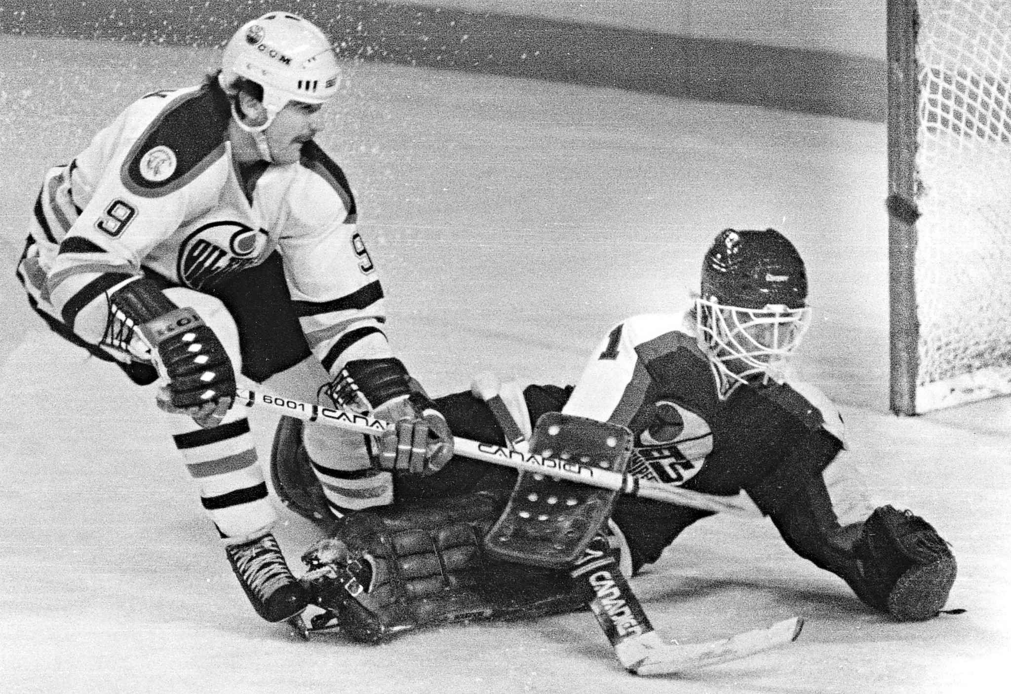 Edmonton Oilers' Glenn Anderson is stopped by Winnipeg Jets' goaltender Brian Hayward during NHL action in 1983.