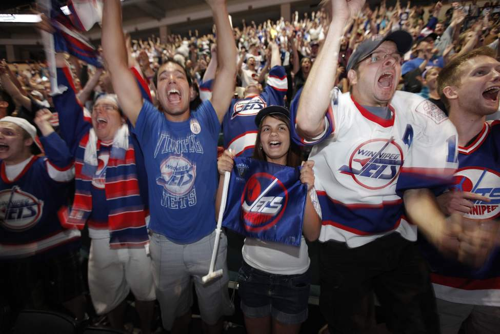 Ryan Purpur, Jesse Martin, Janeen Martin, Ray Braun and Cam Friesen at the MTS Centre in Winnipeg, react after Mark Chipman announces at the NHL draft that the new NHL team in Winnipeg will be called the Jets. June 24, 2011 (JOHN WOODS)