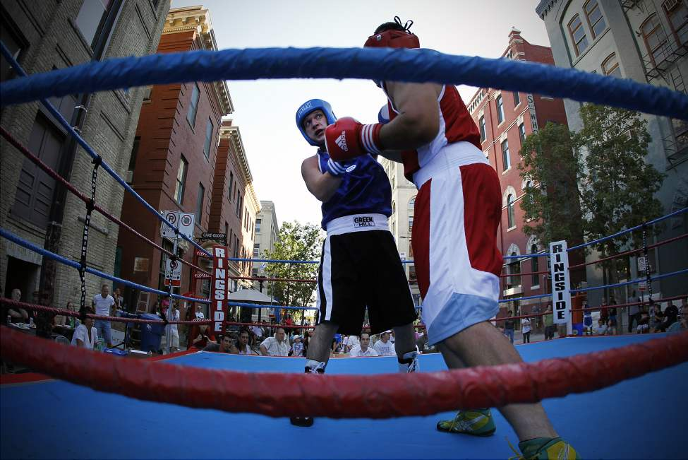 James Hunt (Blue) and Sebastion Jagnyzak (Red) box in the first annual Take It Outside boxing event on Arthur Street in downtown Winnipeg. The event is a fund raiser for disadvantaged youth at Pan Am Place. August 6, 2011