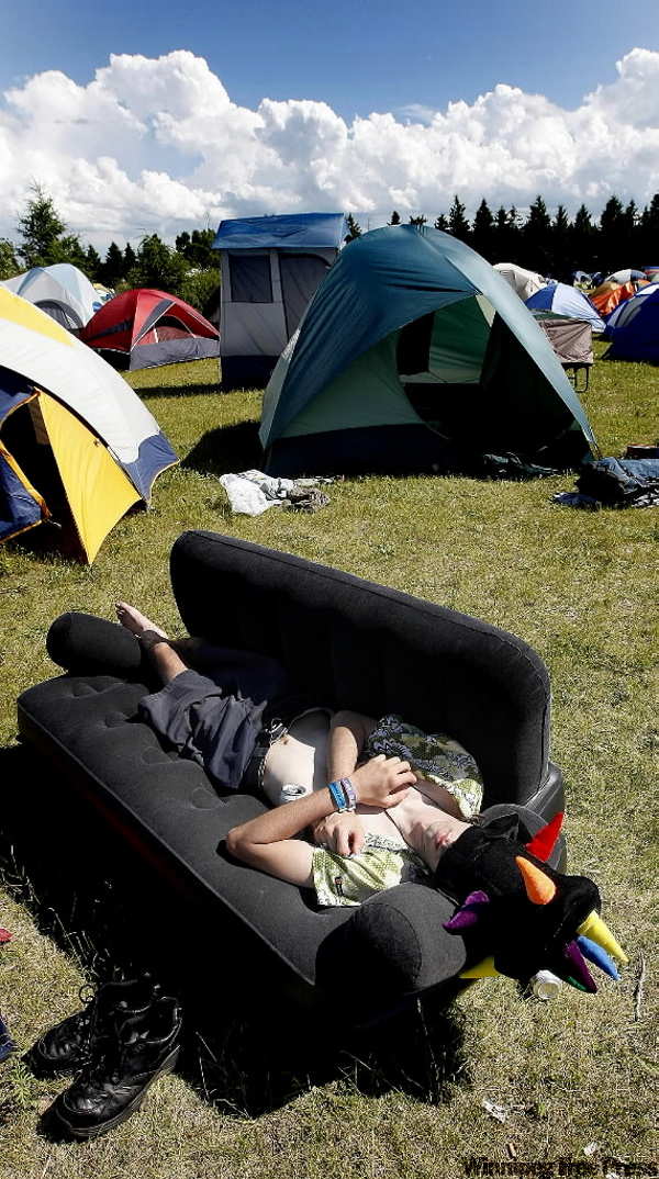 Shoes and party hat at the ready, Matt McKnight sleeps off the first Folk Festival night in the campground. (PHIL.HOSSACK@FREEPRESS.MB.CA)