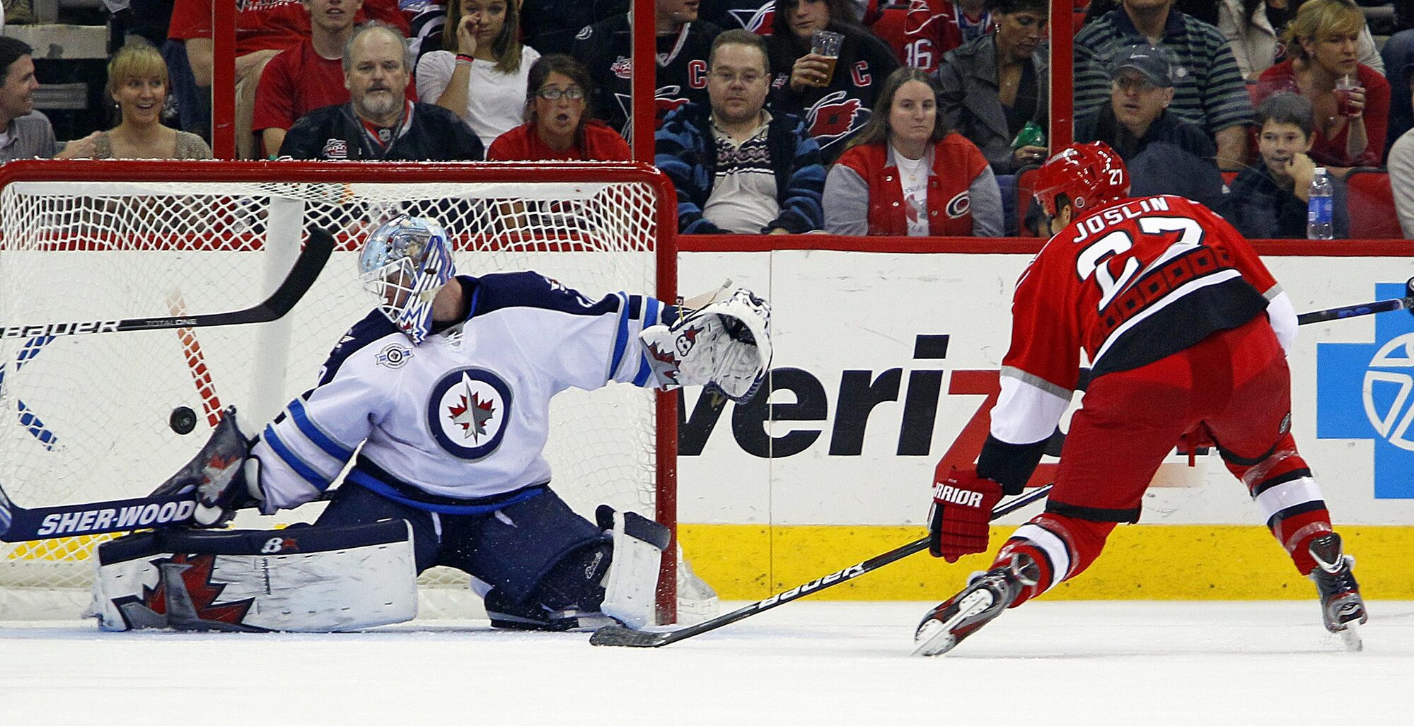 Carolina Hurricanes' Derek Joslin (27) shoots the puck past Winnipeg Jets goalie Chris Mason (50) during the first period of an NHL hockey game in Raleigh, N.C., on Friday.